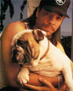 Rapper and actor Ice T, holding a bulldog.